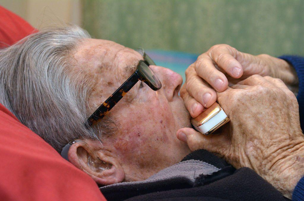 Old man play harmonica