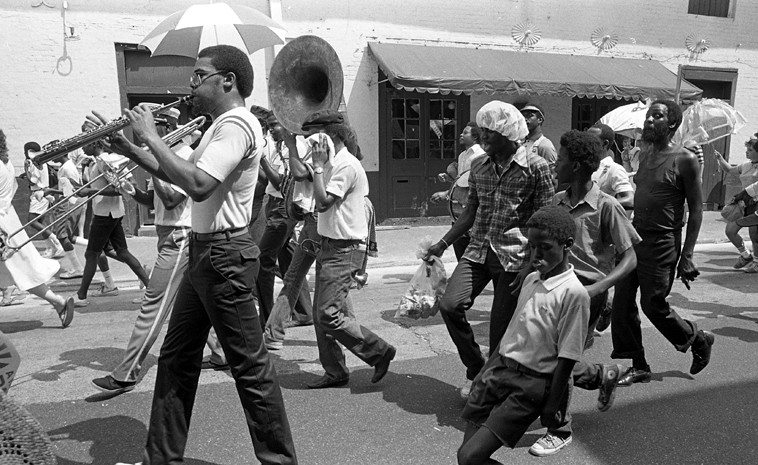 New Orleans parade --  the Histories tell that we are to parade for the dead, march with them onward -- Charles Barbarin Memorial Brass Band -- July 3, 1982 --  French Quarter -- photo by Mark Weber -- In 1928 the Rio Grande in Albuquerque almost claimed the Master of Time & Space Lester Young but for his friend Ben Webster who saved him from joining the Barge of the Dead.