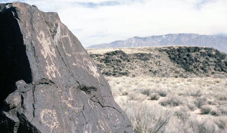 Petroglyphs & Sandia Mountains -- Piedras Marcadas, West Mesa Albuquerque, New Mexico, February 26, 1994 -- photo by Mark Weber WRITING