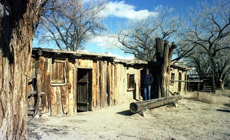Mark Weber at KUNM Studios -- New Mexico -- December 28, 1996 -- (actually, this photo is from one of our frequent weekend road trips back in those days to look around the state and see what there was to see --  this is north-western New Mexico outside Bloomfield at the Salmon Ruins -- this is the bunkhouse from a 19th century homestead on the site of the 11th century Chaco Culture Salmon Ruins outlier) -- photo by Janet Simon