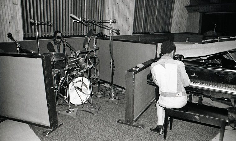 In between takes at the Billie Harris Quintet recording sessions --  April 29, 1980 --  Horace Tapscott and Everett Brown Jr switch places --   HT on drumset ----- United-Western Studios, Hollywood, California -- photo by Mark Weber
