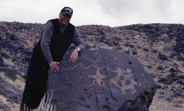 "John Betsch with Star beings (only known to exist in Rio Grande Valley petroglyphs) and a migration symbol and a talking dog ------ March 20, 2000 --- photo by Mark Weber ---- we were laughing because JJ had just seen his first cholla (cactus) and exclaimed ""Sacrebleu! what's this?"""