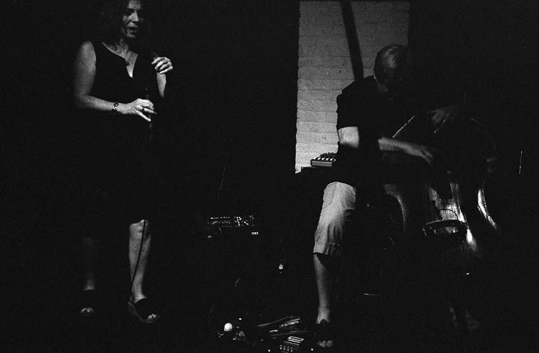 "TranceFormation ----- August 19, 2o14 -- Andrea Wolper, voice; Ken Filiano, bass; Connie Crothers, piano ------ Ken has a little vaudeville in there somewhere: He has a trick headstock scroll that falls off ""accidentally"" so that he can accuse hapless bandmates of breaking his bass (he had it engineered this way so he could take it off for travel -- it reconnects with a dowel post)"