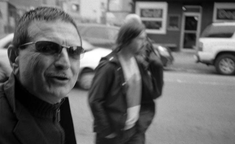 Roger Mancuso on the move ---- I love these kind of shots, where the subject & camera & background  are all in movement -- this is what's called motion parallax, a term mostly used for movie making ----  makes for a dynamic frame ---- November 16, 2o14 -- photo by Mark Weber
