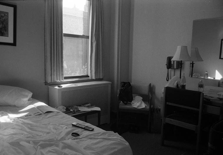 """11:20am -- Room 411 -- my base of operations during my Autumn in New York sojourn -- November 14, 2o14 -- Leo House on 23rd between Eighth & Ninth Avenues, wonderful place, with a quiet breakfast buffet that filled me up with eggs & bacon & hash browns & toast & corned beef hash & yogurt & peaches, pears, orange juice, tea, quiche, blueberry muffins,  pancakes, and apples ---- after such a breakfast I would go sit in the reading room for contemplation (it's a Catholic """"hostelry for travelers"""") with window views of lower Manhattan and just sit and pore over books"""