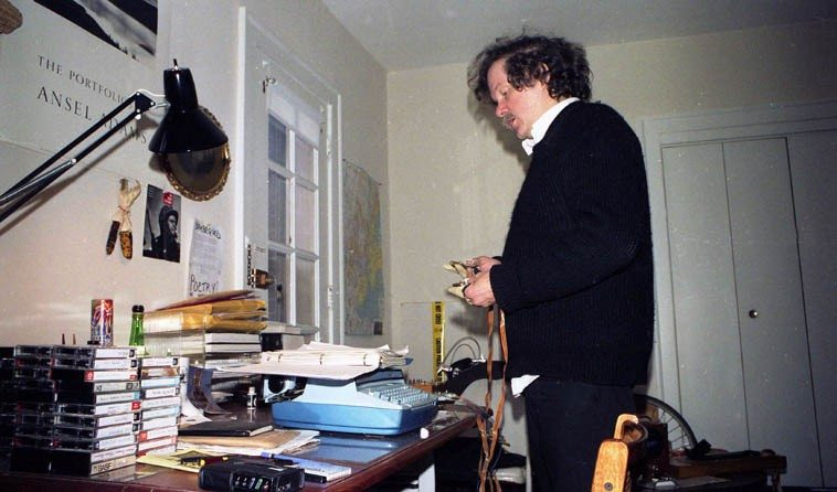 """Ed Sanders rehearsing for his performance at """"days of rain & fire: d.a. levy 20 years after,""""  Case Western Reserve University, Cleveland, Ohio -- October 7, 8, 9, 1988 -- Ed was staying  with us at our apartment in Coventry and that's my writing desk in the picture -- photo by  Mark Weber --- October 8, 1988"""