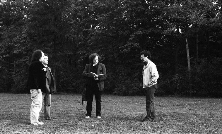 Reading at d.a. levy's grave: Section B, Lot 517 #1 (he shares grave with a Emma Walz), Whitehaven  Memorial Park, 615 S.O.M. Center Road, Mayfield, Ohio -- October 8, 1988 -- photo by Mark Weber --  L to R: Joel Lipmann(?), unknown, Ed Sanders, Geoff Singer -- note that Ed is reading from ukanhavyrfuckincitibak ---- that day of the conference a dozen of us went around Cleveland to  various locations specific to levy's writings and read his poems