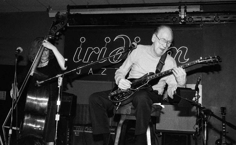 Les Paul Trio -- July 22, 2002 at the Iridium, 1650 Broadway, Manhattan -- Nicki Parrott, bass -- photo  by Mark Weber ------ Nicki Parrott has made a gang of records for the Japanese market, but I've never  heard any of those, so we'll make a selection from one of her many records stateside on the Arbors  label for today's radio show