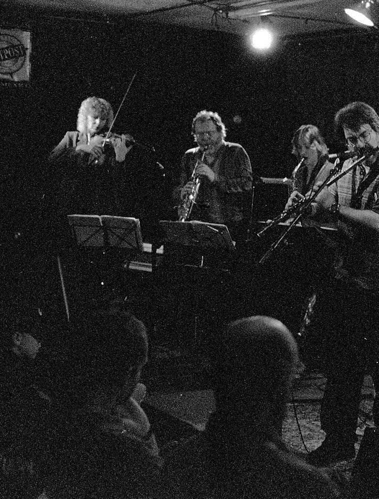 Willem Breuker Kollektief -- Outpost Performance Space, March 30, 2000 -- Lorre Lynn, violin;  Willem Breuker, soprano sax; Hermine Deurloo, alto sax; Alex Coke, flute; (others this night:  Arjen Gorter, bass; Maarten van Norden, saxes; Andy Altenfelder, trumpet; Nico Nijholt, trombone; Bernard Hunnekink, trombone; Henk de Jonge, piano; Boy Raaymakers, trumpet) -- photo by Mark Weber --  Hermine Deurloo has become renowned for her chromatic harmonica which is what we'll be spinning  this radio show