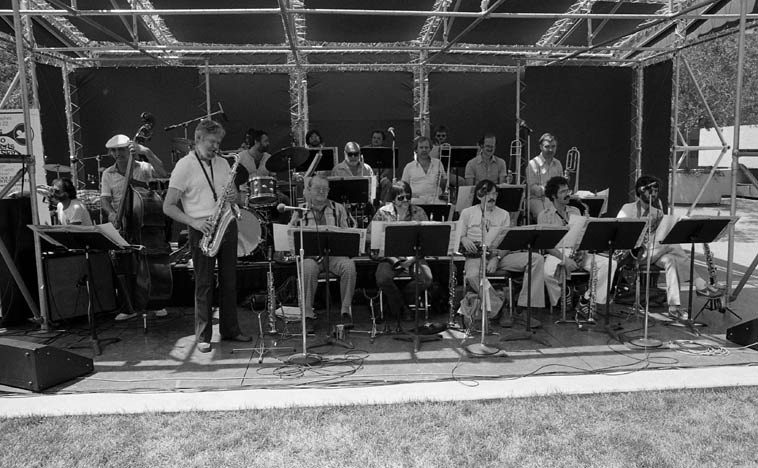 Bill Holman Big Band -- July 25, 1980 at Bonaventure Hotel ---- Milcho Leviev, piano; Monty Budwig, bass;  Nick Ceroli, drums; Dave Levine, conga; Reeds: Bob Cooper, Mike Altshul, Dan Higgins, Bob  Shepherd, Kenny Berger; Trombones: Jack Redman, Rick Pulver, Kenny Shroyer, Bob Enevoldsen;  Trumpets: Bill Stapleton, Bob Szabo, Bob Summers, Don Rader -- photo by Mark Weber -- my notes  say that Bill Holman played soprano & tenor sax and flute, as well as his usual conducting duties that  day, that's him taking a 4th dimension solo rectifying relativity on tenor saxophone