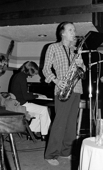Gary Foster and Warne Marsh -- When I came on the set in the early 70s the only Warne records readily available were NE PLUS ULTRA (Revelation) and RELEASE RECORD, SEND TAPE (Wave), and those two labels had a few more but these two became my all-time favorites probably because I played them so much (Now I have 4 feet of shelf space on Warne and some of those records get minimal play simply because of the quantity) -- photos by Mark Weber at Donte's -- February 6, 1977 ---- Gary Foster, alto saxophone; Warne Marsh, cigarette; Alan Broadbent, piano (the photo with Warne playing is the full-frame of the cropped image used on back of Lp HOW DEEP/HOW HIGH (Interplay, 1980) AND on the front the artist David Stone Martin made one of his superb line drawing masterpieces derived thereof ) -- There were no re-issue programs going on in those days so all of Warne's earlier things from the 50s were not around, but we did have the legendary 1949 Capitol recordings with Lennie Tristano on the Lp CROSSCURRENTS