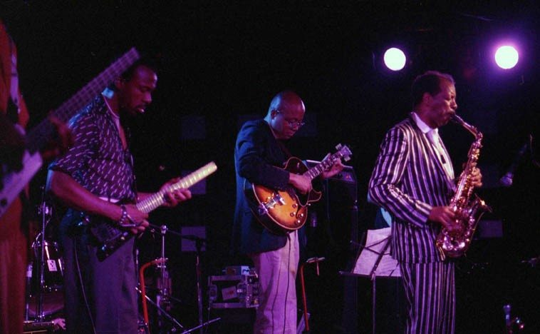 Ornette Coleman & Prime Time -- Charles Ellerbee & Bern Nix, guitars; Jmaaladeen Tacuma & Al MacDowell, electric basses; Sabir & Denardo, drums -- photo by Mark Weber -- June 27, 1986 at Wolfgang's on Columbus Avenue (North Beach), San Francisco
