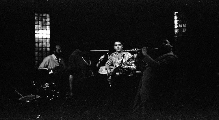 James Newton sitting in with Bob Ferrazza Trio at Club Isabella, Little Italy, Cleveland -- October 18, 1986 -- I was living in Cleveland at the time and James came to town to perform as a feature with a small jazz orchestra at Severance Hall this night and afterwards we hit the clubs, after we closed Isabella I took James to an after-hours club in Kinsman (neighborhood Albert Ayler grew up in) and he sat in with the legendary organist Eddie Baccus ---- I don't know why this negative has deteriorated so badly, but I felt the subject matter worth seeing, Bob is a music teacher at Oberlin ---- photo by Mark Weber