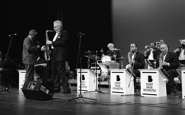 "I wonder how many times Doug has played ""Chelsea Bridge""? Local home boy makes good -- Doug Lawrence with the band he always dreamed about joining while growing up in Albuquerque -- ""Chelsea  Bridge"" was Ben Webster's show piece and now it's one of Doug's features, he played it picture perfect  this night, breathless ---- March 8, 2006 @ Rio Rancho High School Auditorium full to capacity -- The Count Basie Orchestra under the direction of Bill Hughes -- photo by Mark Weber"