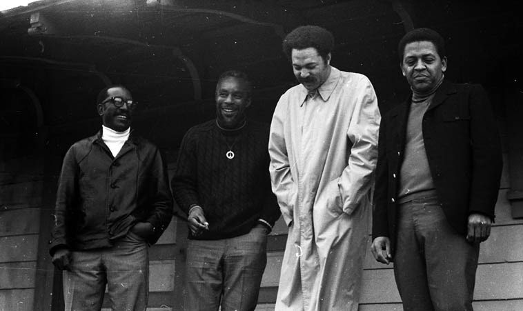 The New Art Jazz Ensemble: John Carter, Bruz Freeman, Tom Williamson, Bobby Bradford -- January  1969 at the Watts Local train stop at 103rd & Grandee (the Red Car went out of service Sept 1961) ----  photo by John William Hardy