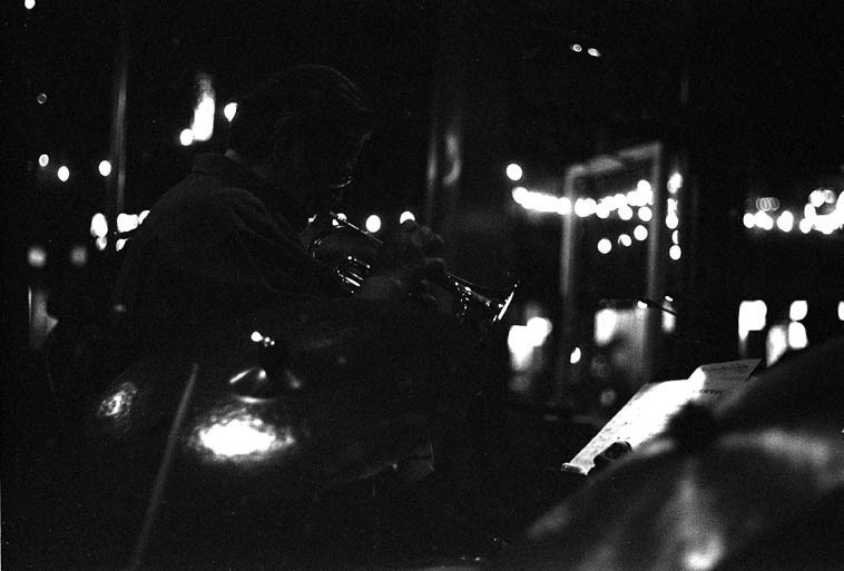 Bobby Shew shot over the shoulder of drummer Cal Haines ---- Friday night club gig in Albuquerque ----  Shew plays cornet, flugelhorn, & trumpet with this particular band of Mickey Patten's (bass) called  the Charlie Christian Project -- August 2, 2o13 ---- Bobby's band plays at the Outpost same night as  the radio show