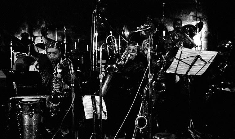 Sun Ra Omniverse Arkestra -- April 2, 1981 -- photo by Mark Weber -- Horace Tapscott told me how the Sun Ra Arkestra show up at his & Cecelia's house on 49th Street in the middle of the night driving 4 old beat-up cars and crashed all over their house -- this is probably the 17-piece band that played at Dorsey High School in April of 1969, their first appearance in Los Angeles, as reported by John Szwed on page 271 of his Ra biography -- Horace always laughed how they were so tired out and slept anywhere, down on the floor, curled up by the couch and on the couch and slumped over in easy chairs and all over . . .