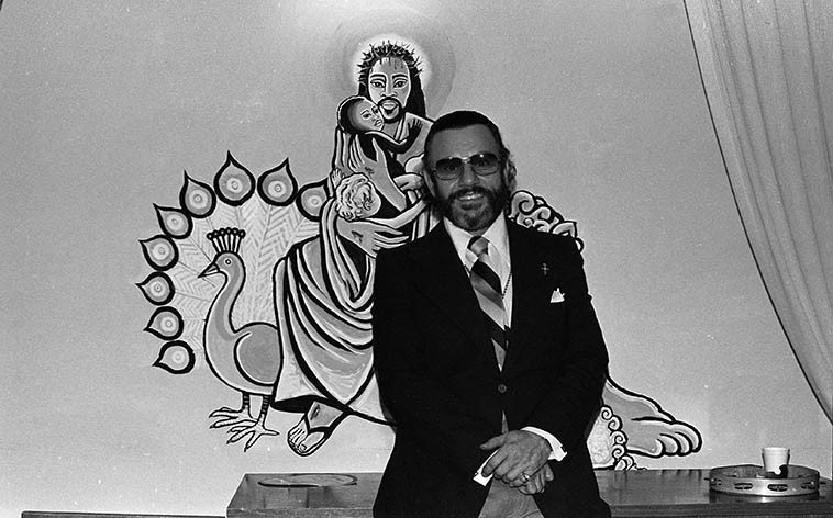 Johnny Otis with his painting of the Black Christ at his Landmark Community Church, 2077 S. Harvard Blvd, Los Angeles ---- Sunday morning October 14, 1979 -- photo by Mark Weber ----  Johnny was busy these years: Besides turning his former home into a church and preaching every  Sunday, he was producing records on his Blues Spectrum label, as well as a weekly radio show on  KPFK
