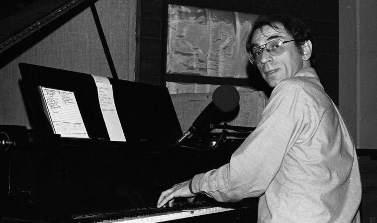 "Dave Frishberg at KPFK live broadcast from Studio A on John Breckow's  all-night jazz radio show -- May 27, 1979 -- photo by Mark Weber -- Dave lived in Los  Angeles (presumably in the Valley?) 1971-1986 (currently resides up the coast in Portland)  ---- this night after an evening of Prez Conference at Donte's we popped in at KPFK (drive down  Lankershim hang a left into Cahuenga Pass) and there's Dave Frishberg telling great stories  about his days with Al & Zoot ---- He had his home-grown rolled in peculiar papers that were  5-inches long (remember Zig-Zags were something like 3) he called this crop ""Van Nuys Silver"""