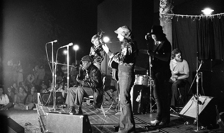 John Lee Hooker -- July 7, 1976 California State University Fullerton -- w/ Ron Thompson (hat)  on guitar and I didn't catch the names of the others but doesn't that bass player look like  Tommy Shannon? -- photo by Mark Weber