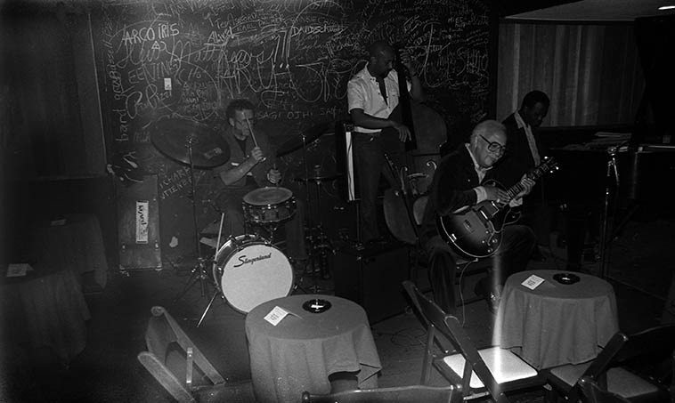 "John Collins Quartet at Donte's, North Hollywood -- Ed Shaughnessy sitting in ---- the Quartet this  night was: Dick Berk, drums; John B. Williams, bass; Gildo Mahones, piano -- May 24, 1982 --  photo by Mark Weber ---- John Collins (1913-2001) was a swing-to-bop era guitarist  who made his  first records in 1931, was with Roy Eldridge 1936-1940, made records with Mildred Bailey and  Billie Holiday, Don Byas, Hot Lips Page, Pete Johnson, made the Decca Tatum sides,  JATP 1946, recorded one of the earliest versions (1946) of ""Epistrophy"" w/ Kenny Clarke's 52nd Street Boys  that included Bud Powell & Fats Navarro, too many people to list, Illinois Jacquet, Tadd Dameron, Coleman  Hawkins, Artie Shaw, Wild Bill Davis, Duke Ellington, and a long tenure (1951-1965) with Nat King Cole,  among OTHERS, but most notably was his close association with the Master of Time & Space (Lester  Young) in small groups on 52nd Street during 1940 & 1941 and as part of Lester's short-lived orchestra  during that time -- So, when John Collins played Donte's we were all there"