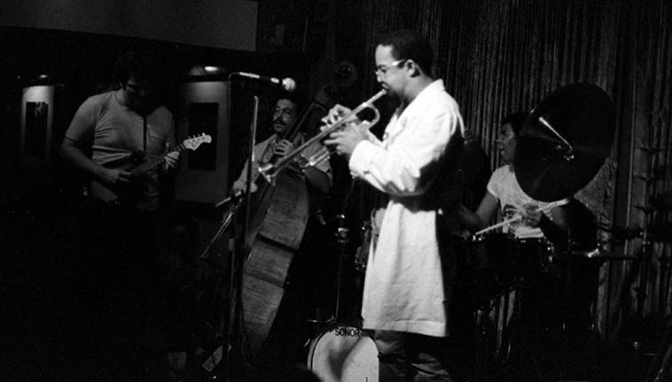 Jack DeJohnette's New Directions at The Lighthouse, Hermosa Beach, California -- September 29, 1978 --  John Abercrombie, mandolin-guitar; Lester Bowie, trumpet; Jack DeJohnette, drums & piano; Eddie  Gomez, bass -- photo by Mark Weber ---- We'll listen to some of 39 STEPS by the same John  Abercrombie Quartet that just played Albuquerque at the Outpost and laid down some of the real  stuff: jazz of such beauty and effortless guileless simple honesty you wish the whole world could  be like that always . . . .