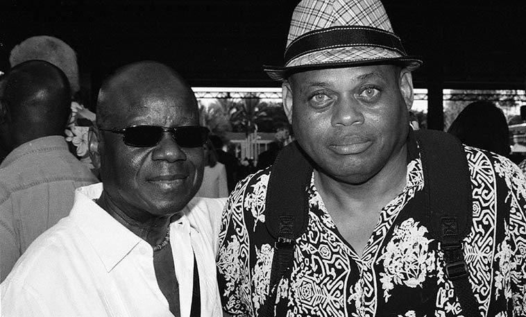 """Fred Jackson & William Roper -- LACMA (Los Angeles County Museum of Art) -- August 14, 2o15 -- photo by Mark Weber ------ William had to fill me in on Mr Jackson: """"That is Fred Jackson, reed player, specializing in lead alto. You have been hearing Fred most of your adult life, backing up many artists, a lot of them of the R&B/Motown variety, but also on many televisions show of yore (like Flip Wilson) and jazz acts. Fred is a jazzman, but like many, he hasn't really led a lot of groups. You won't find much about him on the internet. You really have to nurture an internet presence and he doesn't. He is one of the people I plan to include in my interview series, though he doesn't really do """"out,"""" stuff. He is one of those guys that has helped the world to feel as they feel, that no one knows about."""""""