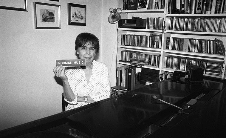 """Virg Dzurinko at her piano in her studio in Harlem -- September 5, 2o15 -- photo by Mark Weber -- (Normal Music is the name of Virg's publishing company) -- the piano is an 1898 Steinway six-four -- her credo for the """"alchemical improvisor"""" is: One thing leads to another . . . . ."""