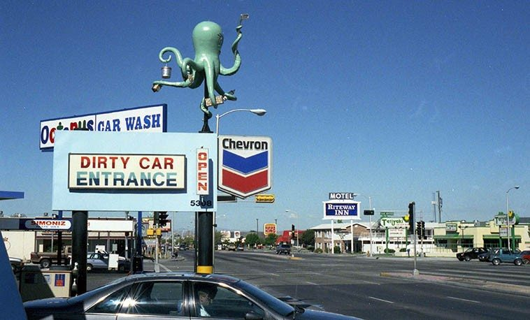 """Octopus Car Wash -- September 11, 1995 -- Central Avenue (old Rt.66) and San Mateo, Albuquerque, (it's no longer there, or anywhere) -- photo by Mark Weber ----- when Horace Tapscott was in town for a couple concerts we were driving past that car wash and Horace said, in his elliptical way: """"I see. Car wash. Octopus really gets it done."""""""