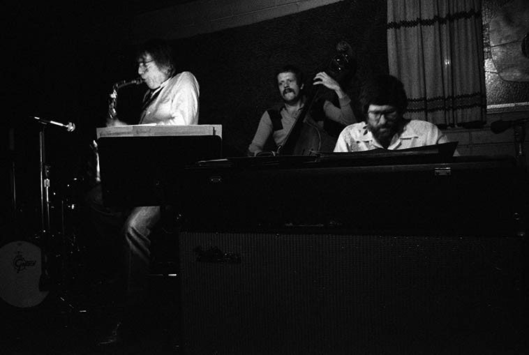 """Bud Shank brought a quartet into Gilberto's -- January 18, 1981 -- Bill Mays, piano; Bob Maize, bass; Jeff Hamilton, drums -- photo by Mark Weber ----------- In Bill Mays memoir STORIES OF THE ROAD, THE STUDIOS, SIDEMEN & SINGERS: 55 YEARS IN THE MUSIC BIZ (2o14) -- a great read, Bill reveals that it was him playing """"the critical opening notes of the song that a contestant would try to guess on the TV show NAME THAT TUNE"""" ----- Bill Mays lived in Los Angeles in the 70s up till 1984 when he relocated to the Chelsea neighborhood on Manhattan (Sheila Jordan lives in Chelsea!)"""