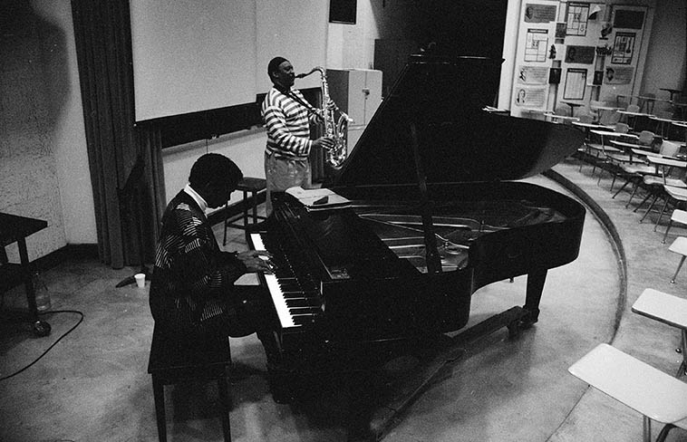 """Don Pullen and George Adams afternoon music clinic at Tri-C Jazz Festival, Cleveland, Ohio -- April 7, 1989 -- photo by Mark Weber ----------- When I asked them about all that bluster from Charles Mingus on stage, when Mingus would yell out directions like a madman: """"B FLAT MOTHERFUCKERS!"""" they told me that Mingus was a pussycat and all that was for show ------- My hair always stood straight up and I was quaking in my boots"""