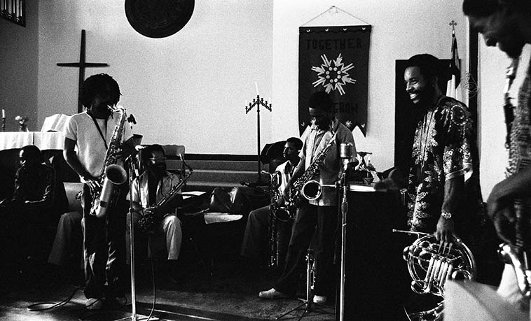 "Pan Afrikan Peoples Arkestra at I.U.C.C. -- June 28, 1981 Los Angeles -- Left to right: Gary Bias (alto); Ufahamu Uweizi (alto -- obscured behind Sabir); Sabir Matteen (tenor solo spot); Dr James Benson (tenor); Ernie Roberts (baritone sax); Arthur Wells (tenor); Fundi LeGogn, (French-horn); Ernie Roberts (bass clarinet -- edge of frame) ---- photo by Mark Weber ----- I remembering knowing Mr Matteen as ""Sabia"" in these days, so, next time I run into him in NYC I got to ask . . . . I'm pretty sure that Horace used to address him as Sabia . . . . ?"