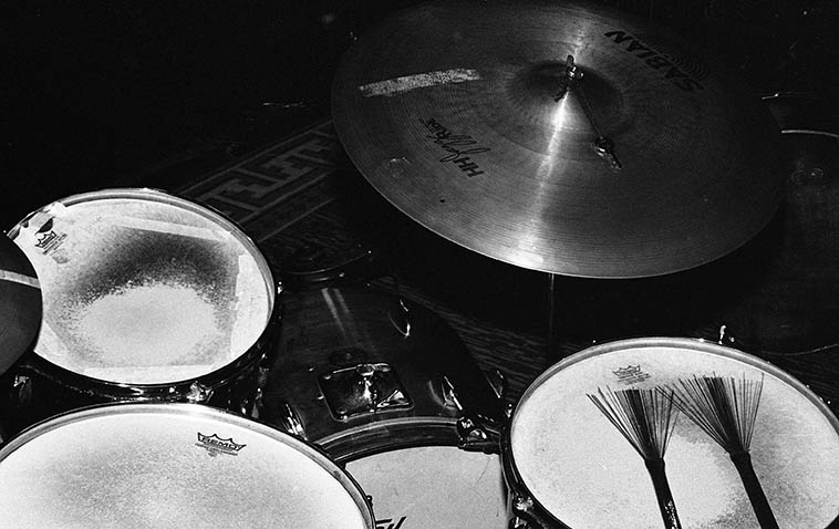 """Bill Chattin's ride cymbal with the keys (he uses keys on both his ride cymbals) -- photo by Mark Weber -- August 24, 2o14 -- """"Lennie (Tristano) actually suggested the idea of putting keys on a string on the ride cymbal -- around 1972-3 -- and I liked the change in sound and have stayed with it."""" [4/24/2o16 email to MW] -- """"I have keys on both my ride and my other cymbal next to my hihat (what many would call a crash, and where a crash would traditionally be) so, my cymbal next to the hihat is more of a secondary ride"""" [email 4/25/2o16] ------ I told him how disorienting it is to see Lenny White play because he's a left-handed person who plays on a right-handed drum set-up. """"Yes, I saw Lenny White years ago. He is a great drummer. I didn't or don't remember that his ride is on the left. Funny you should mention the left hand/right hand thing......I'm left handed! I play the drums strictly right handed. When I first started, age 9, I asked my drum teacher about left and right handed. He thought it best if I learned right handed because, back then, when you marched in a band, the drum was on the left side and naturally lent itself to being played with the left hand facing up and the right hand facing down. The drum was carried off the left hip and naturally slanted down from left to right. Now they stick the drum in front of them perfectly level and play with both hands down......Actually, I'm somewhat ambidextrous."""" [email 4/25/2o16] ----------- I asked Cal about this cymbal thing and he said the crash isn't used that much in jazz, only in big bands, mostly for accents, because the crash has a fast decay, most jazz drummers use a variety of ride cymbals for that spang-a-lang."""