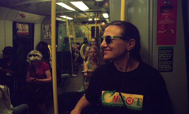 "My traveling companion Janet Simon on the very efficient Stockholm t-bana (tunnelbana) -- June 3, 2o16 -- photo by Mark Weber -- ""Nasta, Skanstull"" the disembodied voice on the intercom intones our next stop, or ""Nasta, Gamla Stan"" or ""Nasta, Hammarbyhojden"""