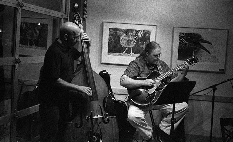 "Michael Olivola and Lewis Winn gig on Central Avenue (Rt.66) at Bumblebee Bob's Baja Grill in Albuquerque -- July 25, 2008 -- photo by Mark Weber ---- When saxophonist Nick Lyons was visiting from NYC I took him to hear the Patti Littlefield Group and afterwards I said What do you think? and he said ""Who's that guitarist?"" and I said That's Lewis Winn, too much, huh? and Nick said, ""Yeh, wow, very intuitional."""
