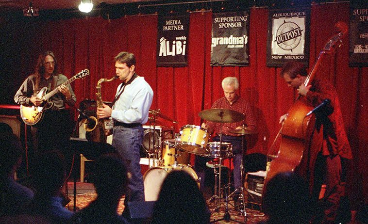 Jon Gagan Quartet: Lewis Winn, guitar; Andrew Poling, drums; Jan Gagan, bass; Kanoa Kaluhiwa (tenor) -- November 9, 1998 Outpost -- photo by Mark Weber -- It would be interesting to know, after all the years Lewis has been studying guitar and teaching guitar if he has winnowed down the guitarists that have had the most impact on him -- who are his pantheon?