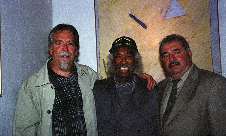 "Mark Weber, Gerald Wilson, Steven Loza -- backstage at the Outpost Performance Space, Albuquerque -- December 4, 2003 ---- I grew up listening to Gerald Wilson's orchestras on the radio in Los Angeles so it was deja vu having him on my radio show that afternoon and this night on stage at the Outpost with a University of New Mexico large jazz band (Steven Loza is a trumpeter and long-time friend of Gerald's and the author of TITO PUENTE AND THE MAKING OF LATIN MUSIC, 1999) -- Gerald brought his wife Josefina to the radio show and I was beside myself as my all-time favorite tone poem of Gerald's is ""Josefina"" and anyone who lived in Southern California during the 1970s heard that tune everywhere, it is so beautiful, and she was so shy I couldn't get her to say a word during the radio hang"